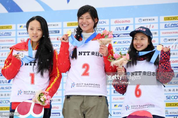 Xuetong Cai of China Jiayu Liu of China and Kurumi Imai of Japan pose on the podium during the medal ceremony for the Snowboarding ladies halfpipe on...