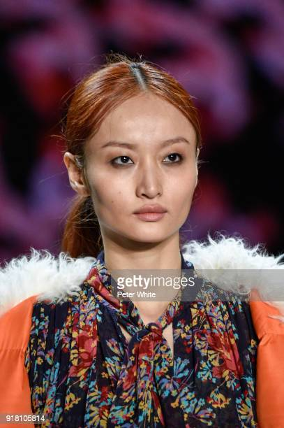 Xuliu Xu walks the runway at the Vivienne Tam show during New York Fashion Week at Gallery I at Spring Studios on February 13 2018 in New York City