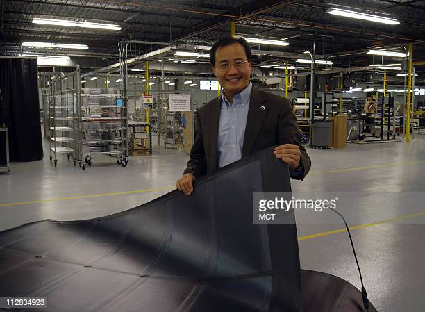 Xunming Deng the CEO of Toledo Ohio company Xunlight Corp shows an example of the company's flexible solar cells Deng a physicist researched a more...