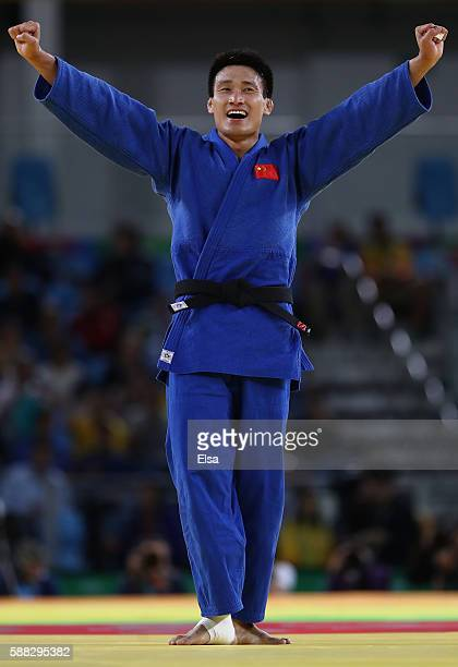 Xunzhao Cheng of China celebrates after defeating Otgonbaatar Lkhagvasuren of Mongolia during the Men's 90kg Bronze Medal B bout on Day 5 of the Rio...
