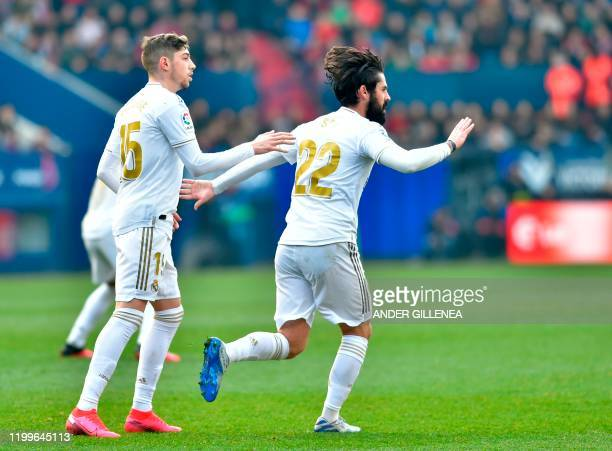 XXReal Madrid's Spanish midfielder Isco celebrates after scoring a goal during the Spanish league football match between CA Osasuna and Real Madrid...