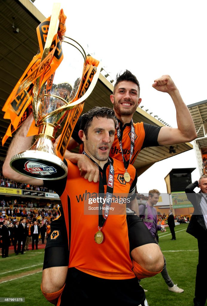 xxxxSamuel Ricketts and Danny Batth of Wolves celebrate with the Sky Bet League One Trophy during the Sky Bet League One match between Wolverhampton Wanderers and Carlisle United at Molineux on May 3, 2014 in Wolverhampton, England.
