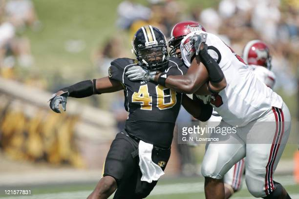 Xzavie Jackson of the Missouri Tigers attempts to break free of a block during a game against the Troy Trojans at Memorial Stadium in Columbia...