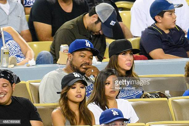 Xzibit and Krista Joiner attend a baseball game between the Colorado Rockies and the Los Angeles Dodgers at Dodger Stadium on September 14 2015 in...