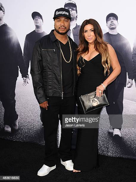 Xzibit and wife Krista Joiner attend the premiere of Straight Outta Compton at Microsoft Theater on August 10 2015 in Los Angeles California
