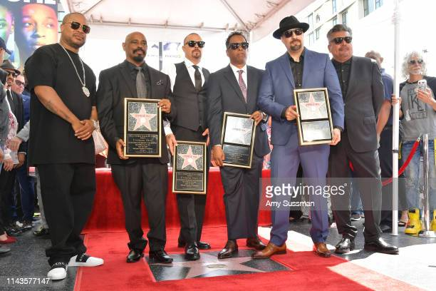 Xzibit Senen Sen Dog Reyes Lawrence DJ Muggs Muggerud Eric Bobo Correa Louis BReal Freese and George Lopez pose with the Cypress Hill star on The...