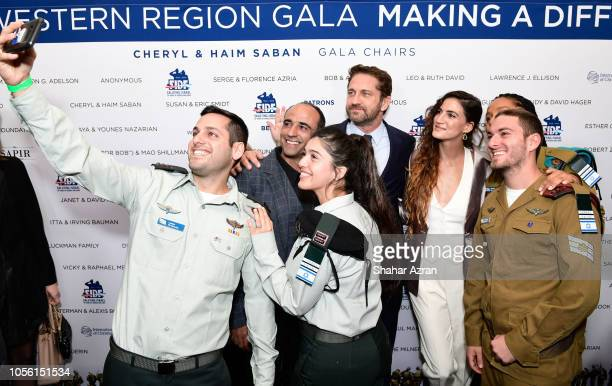 Yaakov Daniel Gerard Butler and RonaLee Shimon and IDF soldiers take a selfie photo at Friends of The Israel Defense Forces Western Region Gala at...