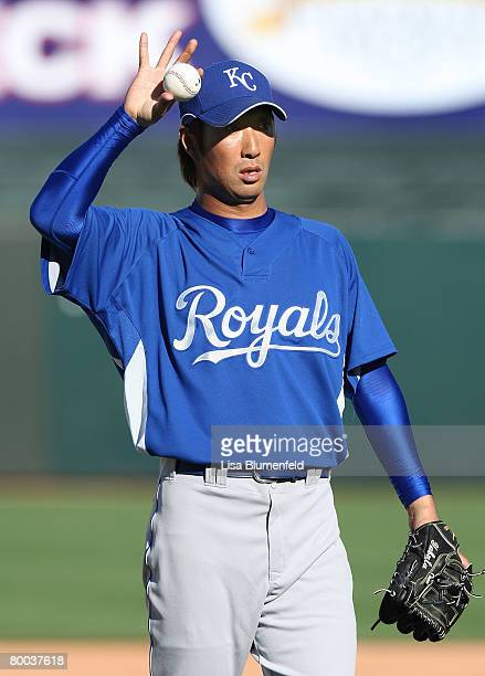 Yabuta Yasuhiko of the Kansas City Royals signals his teammate during the game against the Texas Rangers at Surprise Stadium on February 27 2008 in...
