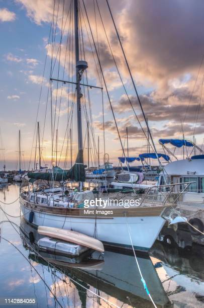 yacht and cloudy sky reflected in urban harbor - marina stock pictures, royalty-free photos & images