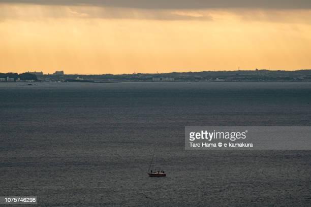 Yacht and morning sunbeam on Kamakura and Yokosuka cities and Sagami Bay in Japan