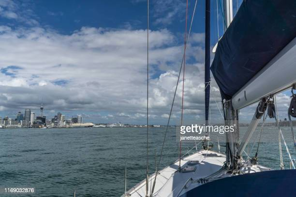 yacht approaching waitemata harbor, auckland, north island, new zealand - waitemata harbor stock photos and pictures