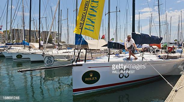 A yacht arrives at dock as crews prepare for the gruelling Sydney to Hobart yacht race which sets sail on Boxing Day in Sydney on December 24 2012...