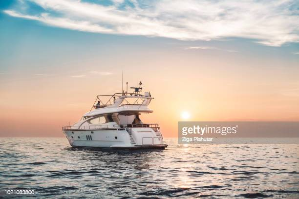yacht in sunset - motorboat stock photos and pictures