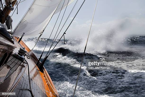 yacht leaning in rough sea. - endurance stock photos and pictures