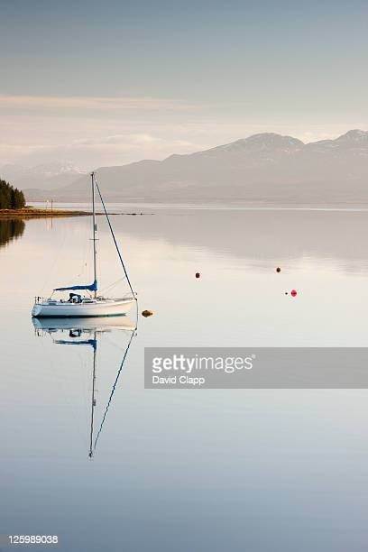 yacht moored on banks of loch ainort on isle of skye, scotland, uk (24th january 2010) - sailing stock pictures, royalty-free photos & images