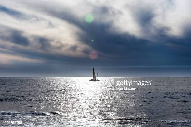 a yacht on the pacific ocean panorama looking west. - メキシコ北部 ストックフォトと画像