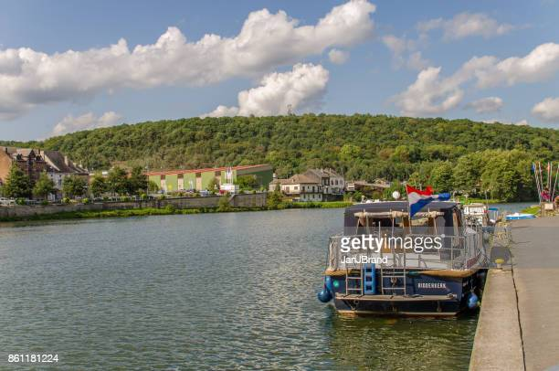a yacht on the river meuse - meuse river stock photos and pictures