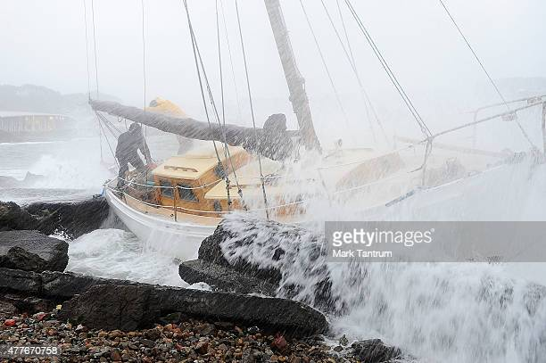 A yacht owned by Matthew Wilson is washed onto rocks at Evans Bay on June 19 2015 in Wellington New Zealand Strong force winds and heavy rain is...