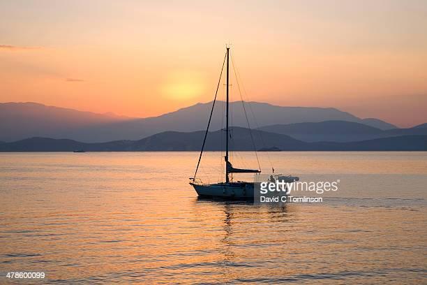 Yacht putting to sea at dawn, Kassiopi, Corfu