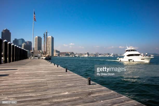 Yacht sailing across the dock