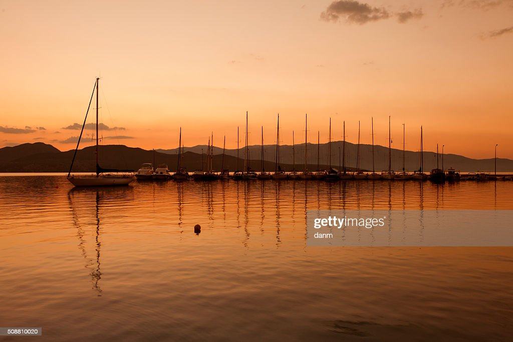 yacht sailing against sunset holiday lifestyle landscape with