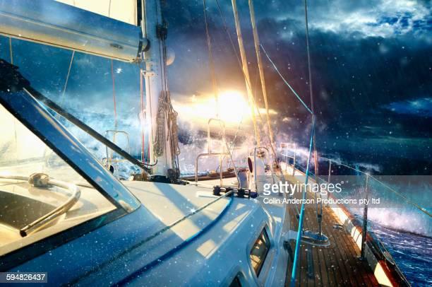Yacht sailing on stormy seas