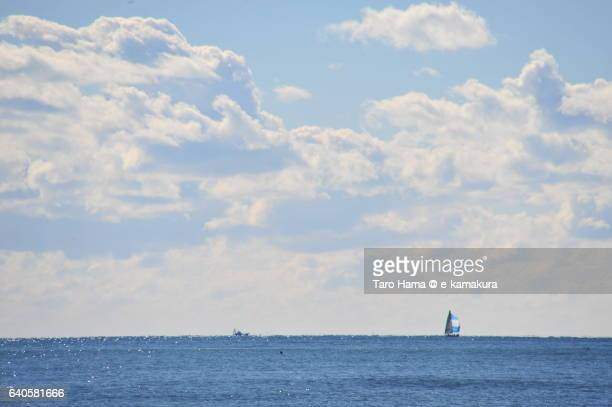 A yacht sailing on sunny beach in winter