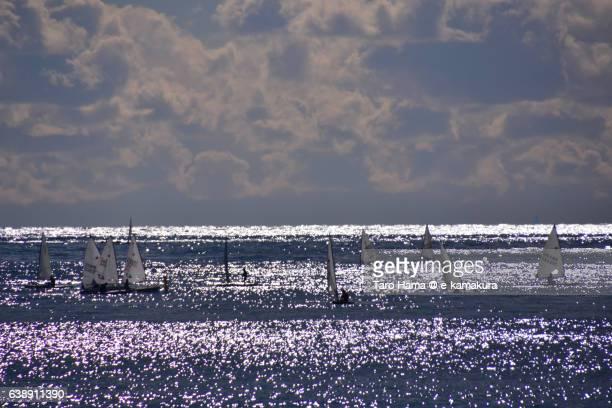 Yacht sailing on the silent and sunny beach