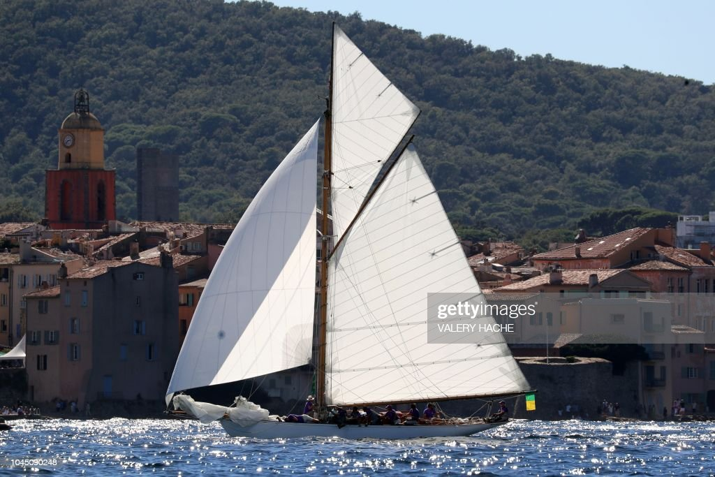 A yacht sails off the coast of the southern French city of Saint