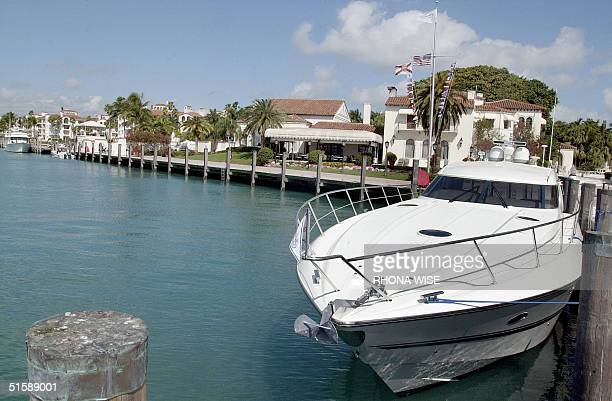 A yacht sits tied up in a slip outside the Vanderbilt Mansion on Fisher Island an exclusive golf tennis and spa community located in South Florida 08...