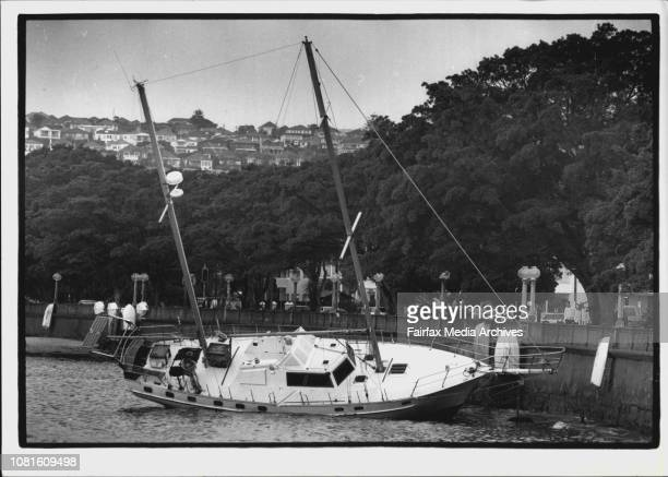 A yacht that broke its mooring during the night and was washed into the wall at Rose BayWashed up the yacht that broke from its moorings lies close...