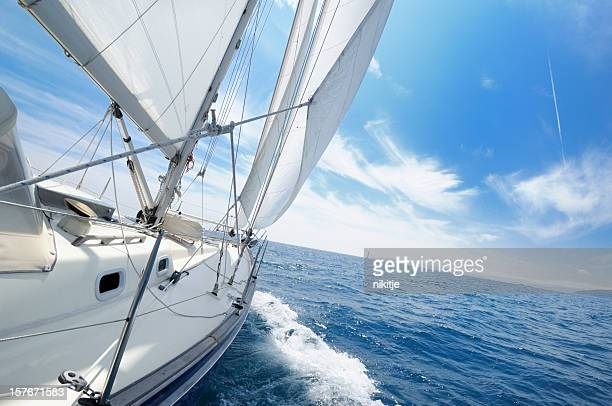 yacht under sail on the sunny day - sailor stock pictures, royalty-free photos & images