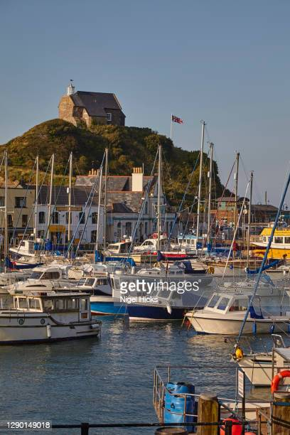 a yacht-filled harbour bathed in evening sunlight; ilfracombe, on the north coast of devon, southwest england. - ilfracombe stock pictures, royalty-free photos & images