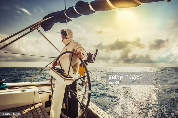 yachting adventure man - team captain stock pictures, royalty-free photos & images