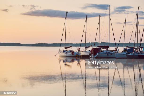 yachts and boats moored in a harbour at sunrise. candid people, real moments, authentic situations - poland stock pictures, royalty-free photos & images