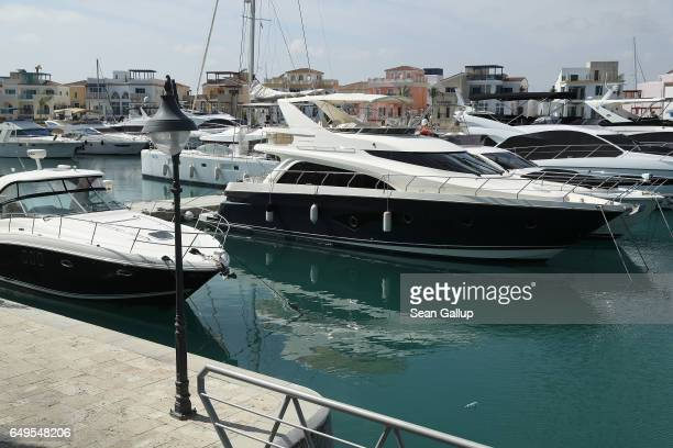 Yachts and luxury residences stand at Limassol Marina on March 8 2017 in Limassol Cyprus Cyprus has largely recovered from its 20122013 economic...