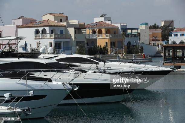 Yachts and luxury residential housing stand at Limassol Marina on March 8 2017 in Limassol Cyprus Cyprus has largely recovered from its 20122013...