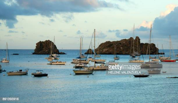 Yachts are anchored at Gustavia Harbour on the French Caribbean island of SaintBarthelemy on December 12 a day after his funeral PHOTO / Helene...