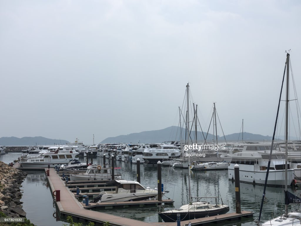Yachts are moored at a marina in Discovery Bay, a residential project developed by Hong Kong Resort Co., on Lantau Island in Hong Kong, China, on Tuesday, March 27, 2018. Private homes in Discovery Bay currently sell from about HK$8 million to HK$80 million, said Denis Ma, head of research for Hong Kong at real-estate services company Jones Lang LaSalle Ltd. Photographer: Justin Chin/Bloomberg via Getty Images