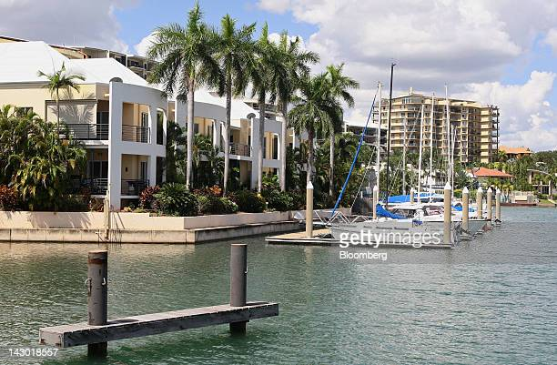 Yachts are moored in front of residential properties at Cullen Bay Marina in Darwin Australia on Wednesday April 11 2012 Darwin is in the express...