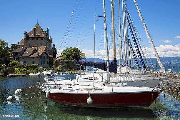 Yachts by the 12th Century medieval castle in the old port of Yvoire on Lac Leman Lake Geneva France