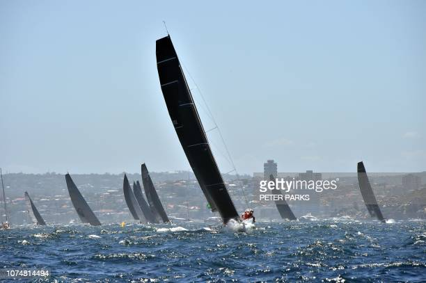 TOPSHOT Yachts compete at the Sydney to Hobart yacht race on December 26 2018 / IMAGE RESTRICTED TO EDITORIAL USE STRICTLY NO COMMERCIAL USE