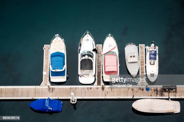 yachts in dubai marina - moored stock pictures, royalty-free photos & images