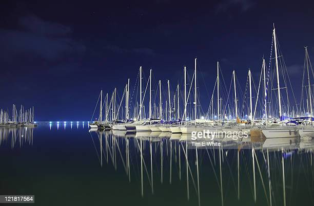 yachts in harbour at night, alghero, sardinia, italy - marina stock pictures, royalty-free photos & images