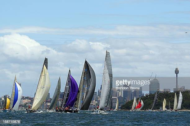 Yachts jostle for position at the start of the 2013 Sydney to Hobart on Sydney Harbour on December 26 2012 in Sydney Australia