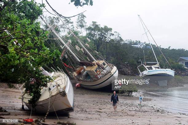 Yachts litter the shoreline after being washed ashore by Cyclone Ului at Shute Harbour near Airlie Beach along the Queensland state coast on March 21...