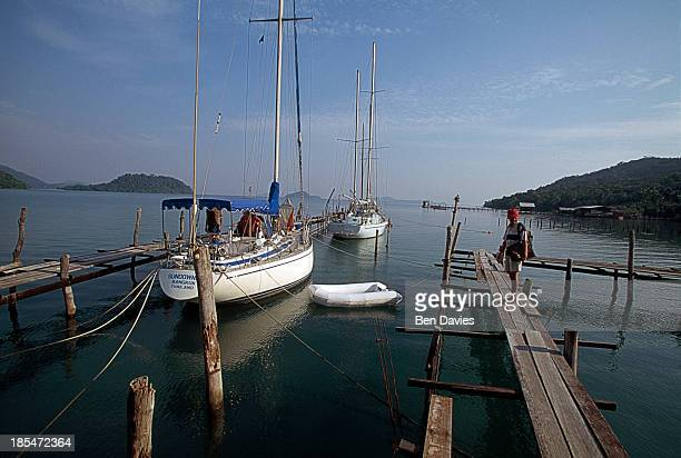 Yachts moored against the pier on the east coast of Ko Chang. One of the largest and most beautiful islands in the whole of Thailand, Koh Chang...
