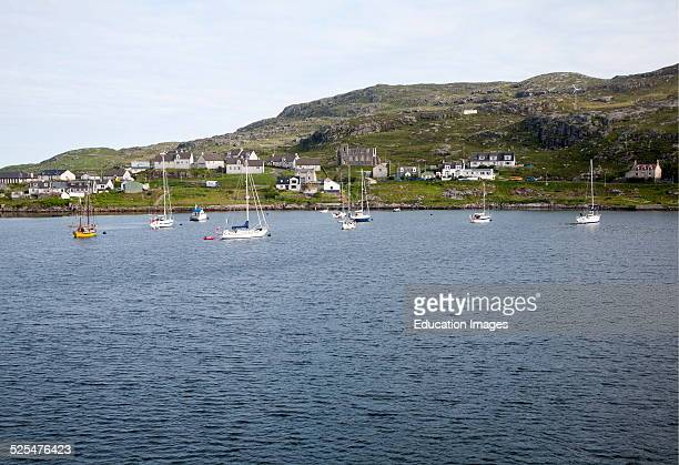 Yachts moored in the harbor at Castlebay Barra Outer Hebrides Scotland