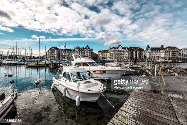 yachts moored on lake geneva - vaud canton stock pictures, royalty-free photos & images
