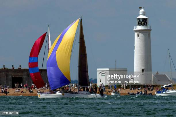 Yachts pass Hurst Light House with spinnakers flying at the start of the race